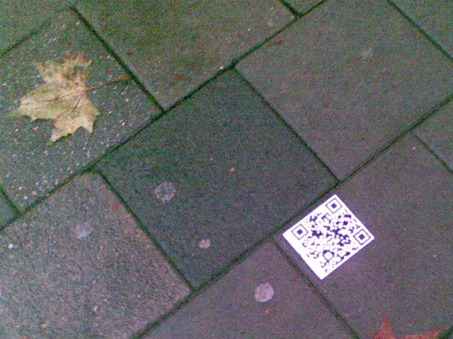 Picture of a QR code sticker near Breda Central Station